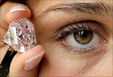 A rare intense purple-pink cut-cornered rectangular mixed-cut diamond ring.