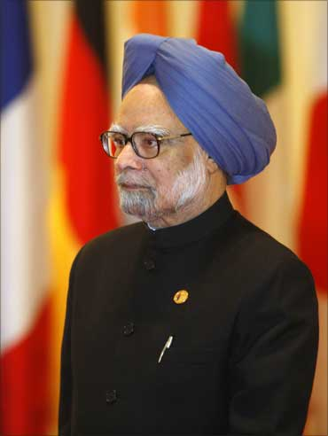 Prime Minister Manmohan Singh arrives for the opening plenary session of the G20 Summit in Seoul on November 12, 2010.