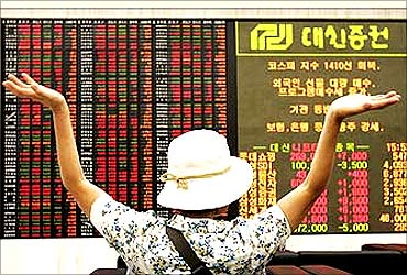 An investor looks at stock price index in Seoul.