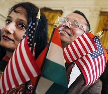 People hold American flags.
