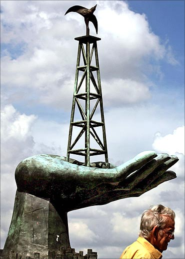 statue depicting an oil rig is seen in front of the Energy Ministry building in Caracas.