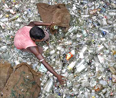 A labourer works at a glass bottle recycling factory.