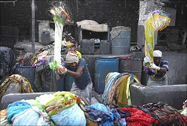 Laundrymen work at the Dhobi Ghat open air laundry in Mumbai.