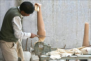 A worker makes an artificial limb at a workshop in New Delhi.