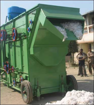 Cotton stripping machine.