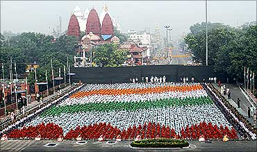 School children participate in a full-dress rehearsal during Independence Day celebrations at Red Fort.