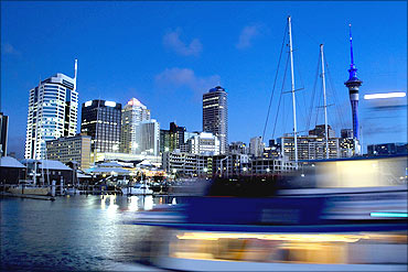 Viaduct Harbour is seen in the foreground, the Sky Tower at right.
