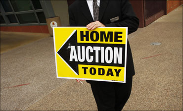 A home auction sign.