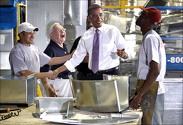 US President Barack Obama with workers during a tour of Stromberg Metal Works.