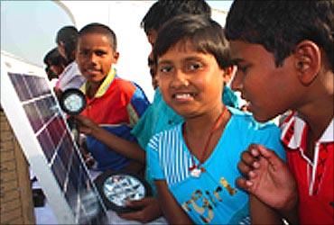 Children with solar lights.