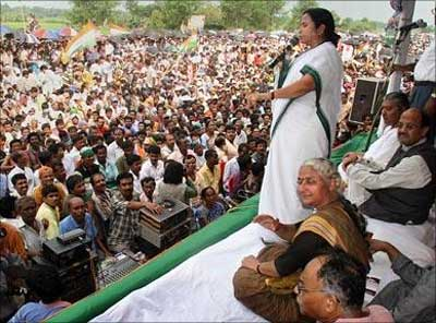 Chief of the regional Trinamool Congress party, speaks during a protest rally in front of Tata Motors' new small car project, the Nano, at Singur.