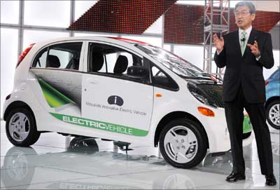 Shinichi Kurihara, President and CEO of Mitsubishi Motors North America, introduces the Mitsubishi i electric vehicle.