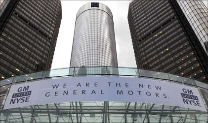 A banner hangs at the front of the General Motors Co world headquarters.