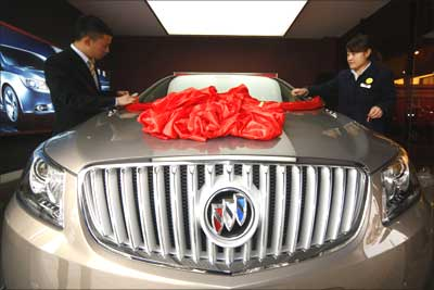 Staff decorate a Buick Regal car at a General Motors auto dealership in Suining,Sichuan province.