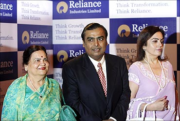 Mukesh Ambani with mother Kokilaben (left) and wife Nita.