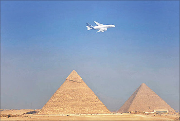 A380 flies over the Pyramids.