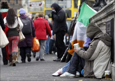 Homeless people beg for money on O'Connell Bridge in central Dublin.
