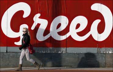 A pedestrian walks past graffitti in Dublin.