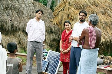 Vinay, Piyush  and Ekta with villagers.
