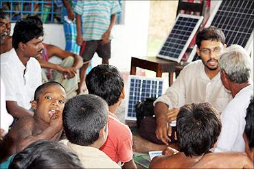 Vinay Jaju with villagers.