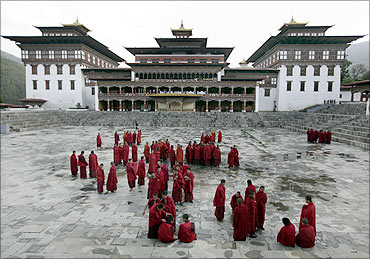 Buddhist monks stand inside the complex of Tashichhodzong in Bhutan's capital Thimphu.