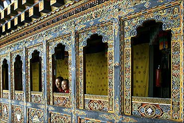 Monks look out of a temple in Tango monastery on the outskirts of Thimphu.