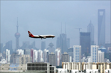 A Shanghai Airlines' passenger airliner flies towards Hongqiao Airport in Shanghai.