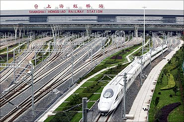 A high-speed train travels on the newly built Shanghai-Hangzhou railway in Shanghai.