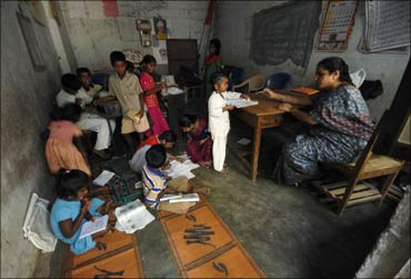 Students and a teacher in a school classroom.