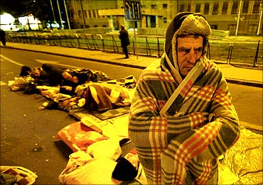 Unemployed workers spend the night in front of the Macedonian Parliament during a protest.