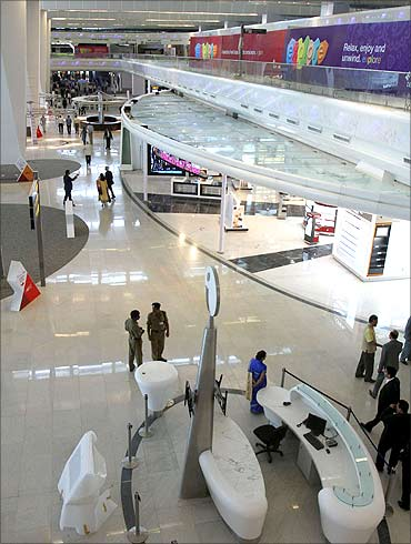 People walk inside Terminal 3 of the New Delhi International Airport.