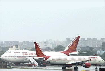 Air India on the tarmac during heavy rains at the Indira Gandhi International Airport.