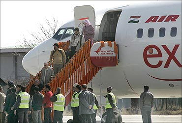 Passengers disembark an Air India aircraft.