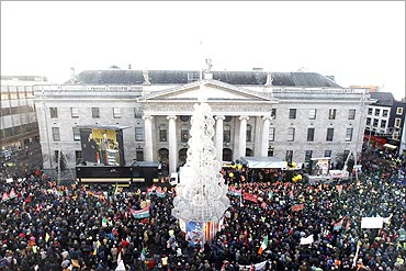 People gather in front of the General Post Office Building on O'Connell Street, in Dublin.