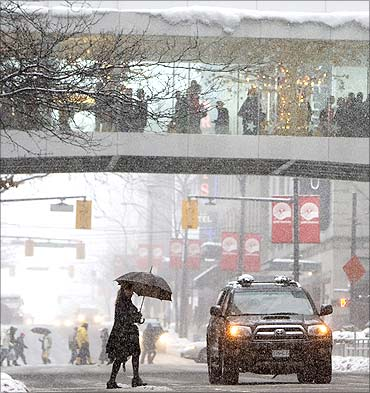 Shoppers out in snowy Vancouver.