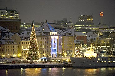 A traditional Christmas tree is seen on the Skeppsbro quay, Stockholm.