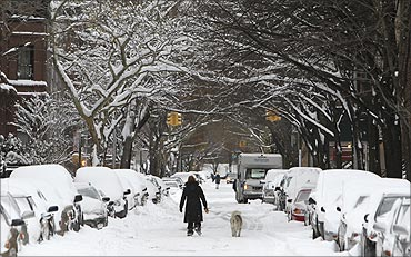 Snow covers a street in Brooklyn, New York.