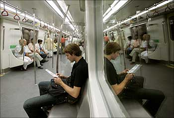 Commuters in a Delhi Metro rail.