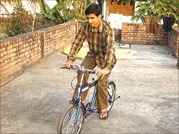 Sandeep with his bicycle.