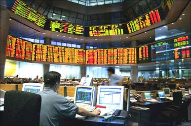 A broker at work in the Malaysia Stock Exchange.