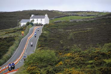 Motorcyclists ride their bikes on the roads at Creg-ny-Baa during 'Mad Sunday' at the TT meeting, on the Isle of Man.