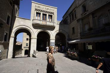 A woman passes the headquarters of Cassa di Risparmio, the largest bank in San Marino.