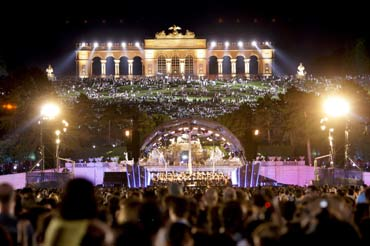 The 'Gloriette' is seen above a stage set up in the park of Schoenbrunn castle as the Vienna Philharmonic Orchestra performs their 'Sommer Night Concert' in Vienna.