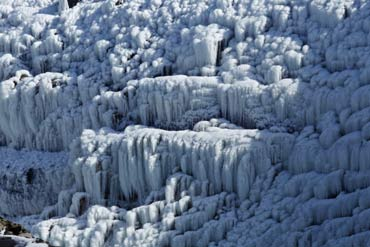 An ice-covered cliff is seen in Golfoss, Iceland.