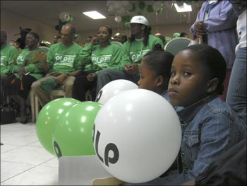 A girl holds a balloon at an election rally of Bermuda's ruling Progressive Labour Party in the capital of Hamilton.