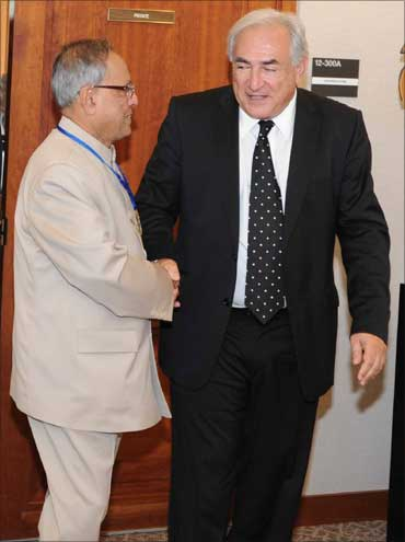 Finance Minister Pranab Mukherjee greets IMF Managing Director Dominique Strauss-Kahn.