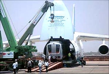An Antonov cargo aircraft carrying a new metro rail carriage.