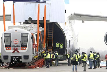 A rail carriage is loaded into an Antonov 124 cargo aircraft.