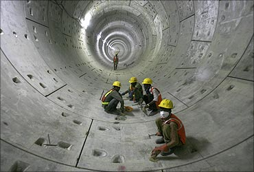 Delhi Metro Rail Corporation employees work inside a tunnel on the phase II stretch.