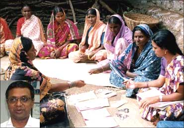 An SKS staff working with village women. Inset: Suresh Gurumani.